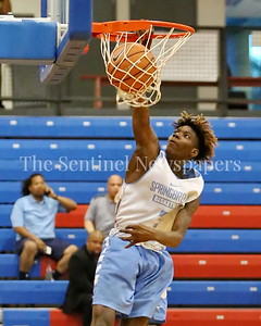 George P. Smith/The Montgomery Sentinel    Springrook High School's Timitrius Hawkins (3) with the dunk during the Capitol Hoops Summer League game played at DeMatha High School Friday, June 15, 2018.