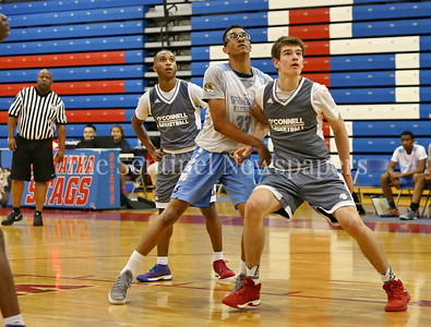 George P. Smith/The Montgomery Sentinel    Bishop O'Connell High School's Charlie Webber (33) boxes out Springrook High School's Timothy Poyal (33) as Ayan Teel looks on during the Capitol Hoops Summer League game played at DeMatha High School Friday, June 15, 2018.