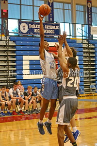 George P. Smith/The Montgomery Sentinel    Springrook High School's Jonathan Lapierre (23) with the runner from the paint during the Capitol Hoops Summer League game played at DeMatha High School Friday, June 15, 2018.