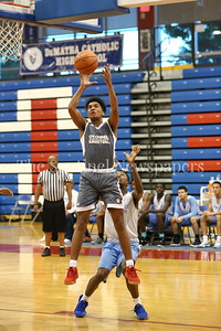 George P. Smith/The Montgomery Sentinel    Bishop O'Connell High School's Jordan Brown (1) gets in front of Springrook High School's Jayani Gillisie (11) during the Capitol Hoops Summer League game played at DeMatha High School Friday, June 15, 2018.
