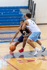 6/25/2018 - Good Counsel's Antoine Jacks (7) guarded by Whitman's Kai Halloway (1), Capitol Hoops Summer League at DeMatha High School, Good Counsel v Whitman Boys Basketball, ©2018 Jacqui South Photography
