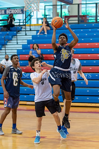 6/25/2018 - Good Counse's Phillip Carter (5) shoots a layup over Whitman's Jaden Pierce (11), Capitol Hoops summer league at DeMatha High School, Good Counsel v Whitman Boys Basketball, ©2018 Jacqui South Photography