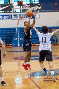6/25/2018 - Good Counsel's Antoine Jacks (7) shoots a jump shot over Whitman's Jaden Pierce (11), Capitol Hoops Summer League at DeMatha High School, Good Counsel v Whitman Boys Basketball, ©2018 Jacqui South Photography