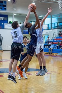 6/25/2018 - RJ Floyd (44) shoots between two Whitman defenders Jay McClelland (5) & Brendan Shaver (3) , Capitol Hoops summer league at DeMatha High School, Good Counsel v Whitman Boys Basketball, ©2018 Jacqui South Photography