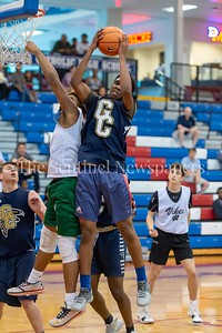 6/25/2018 - Good Counsel's Jalen Curtis (46) pulls down a defensive rebound, Capitol Hoops summer league at DeMatha High School, Good Counsel v Whitman Boys Basketball, ©2018 Jacqui South Photography