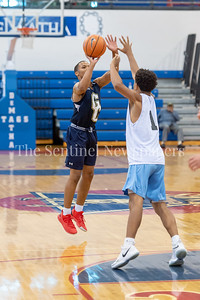 6/25/2018 - Good Counsel's Antoine Jacks (7) shoots a 3-point shot over Whitman's Kai Halloway (1), Capitol Hoops Summer League at DeMatha High School, Good Counsel v Whitman Boys Basketball, ©2018 Jacqui South Photography