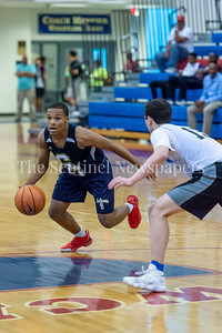 6/25/2018 - Good Counsel's Antoine Jacks (7) guarded by Whitman's Jason Lewis (15), Capitol Hoops Summer League at DeMatha High School, Good Counsel v Whitman Boys Basketball, ©2018 Jacqui South Photography