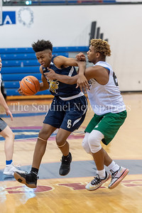 6/25/2018 - Good Counsel's Phillip Carter (5) drives into the lane guarded by Whitman's Bert Tillett (87), Capitol Hoops summer league at DeMatha High School, Good Counsel v Whitman Boys Basketball, ©2018 Jacqui South Photography