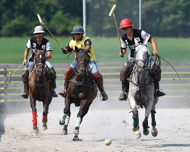 George P. Smith/The Montgomery Sentinel    Andres Prado (3), Nivedita Chauhan (1) and Lautaro Garcia (1) chase a polo ball during a polo match at the Congressional Polo Club in Poolesville, Maryland on Sunday, August 5, 2018.
