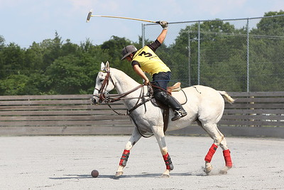 George P. Smith/The Montgomery Sentinel    Greg Gregorian takes a big swing at the ball during a polo match at the Congressional Polo Club in Poolesville, Maryland on Sunday, August 5, 2018.