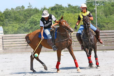 George P. Smith/The Montgomery Sentinel    Andres Prado (3) and Federico Potel (2) battle over the ball during a polo match at the Congressional Polo Club in Poolesville, Maryland on Sunday, August 5, 2018.