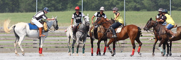 George P. Smith/The Montgomery Sentinel    Referee Sid Miller bowls-in a polo ball down the center of the two teams during a polo match at the Congressional Polo Club in Poolesville, Maryland on Sunday, August 5, 2018.