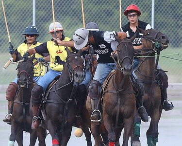 George P. Smith/The Montgomery Sentinel    (L-R) Nivedita Chauhan, Federico Potel, Eloris Snyder (partially obscured), and Lautaro Garcia watch as Andres Prado looks for the ball in close quarters during a polo match at the Congressional Polo Club in Poolesville, Maryland on Sunday, August 5, 2018.