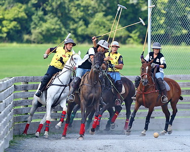 George P. Smith/The Montgomery Sentinel    (L-R) Greg Grigorian (3), Andres Prado, Lautaro Gracia (obscured), Federico Potel (2), and Eloris Snyder (2) battle for position on the ball during a polo match at the Congressional Polo Club in Poolesville, Maryland on Sunday, August 5, 2018.