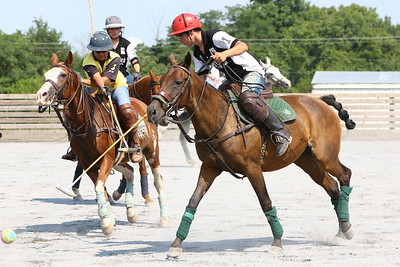George P. Smith/The Montgomery Sentinel    Lautaro Garcia advances the ball on the off-side and Nivedita Chauhan tries to block on the near side during a polo match at the Congressional Polo Club in Poolesville, Maryland on Sunday, August 5, 2018.