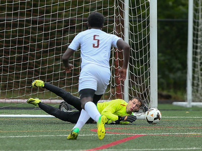 Paint Branch Goalkeeper David Burgess watches helplessly as the rebound from his save attempt is put back in by B-CC's Cooper Clendenin. PHOTO BY MIKE CLARK