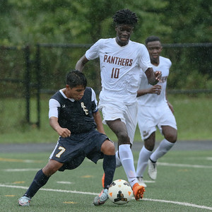 B-CC Baron's speed, Paint Branch's physical play, and the rain all dominated. The result was a 1-1 tie after double overtime. PHOTO BY MIKE CLARK