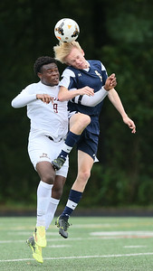 Bradley Muma (9) of Paint Branch battles Carl Lauridsen (6) of B-CC for the ball. PHOTO BY MIKE CLARK