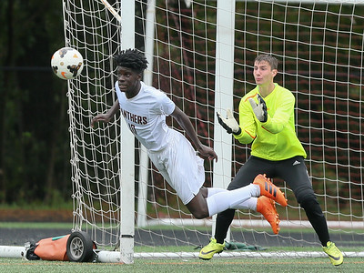 Paint Branch's Brian Noutchang intercepts B-CC's shot on goal. PHOTO BY MIKE CLARK