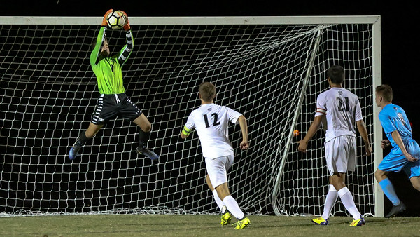 Ryan Oxenford of the Northwest Jaguars skies for the save en route to a shut-out against rival Clarksburg Coyotees. PHOTO BY MIKE CLARK
