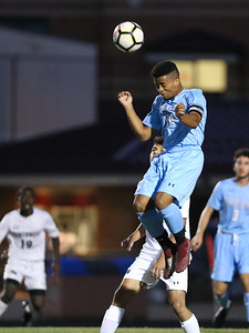Clarksburg's Foster Taylor times this header perfectly. PHOTO BY MIKE CLARK