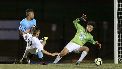Northwest Jaguars' Samuel Zapata's shot is stopped here by Clarksburg Goalie Marlon Lopez. Zapata later scored on a penalty kick. PHOTO BY MIKE CLARK