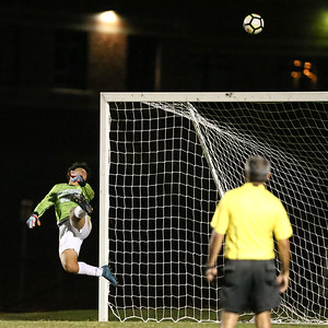 Clarksburg Goalie Marlon Lopez gets a hand on this shot on goal and watches the ball sail high above the goal. PHOTO BY MIKE CLARK