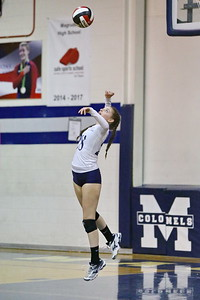 George P. Smith/The Montgomery Sentinel    Col. Zadok A. Magruder High School's Katie Stevens-Donati (28) serving during the game against Northwood High School played at Magruder on Monday, September 24, 2018.
