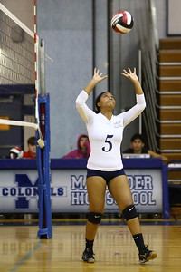 George P. Smith/The Montgomery Sentinel    Col. Zadok A. Magruder High School's Tonessa Jhingory (5) setting the ball during the game against Northwood High School played at Magruder on Monday, September 24, 2018.