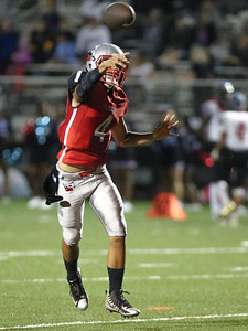 Blair High School Quarterback Pablo Perez leads his blazers to a 20-0 homecoming win over Einstein. PHOTO BY MIKE CLARK