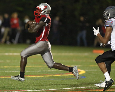 Blair star Running Back Brandon Ntankeu breaks tackles to score a touchdown on the last play of the game against Einstein. PHOTO BY MIKE CLARK