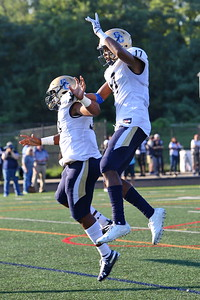 George P. Smith/The Montgomery Sentinel    Our Lady of Good Counsel High School's Mitchell Melton (17) celebrates with Adrian Sargent (33) after getting in the endzone untouched against Northwest High School to put the Falcons up 41-0 with 4:20 left in the 2nd quarter of the game played at Gaithersburg High School on Saturday, September 29, 2018 due to wet field conditions at Northwest.