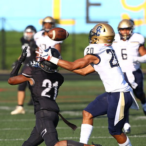 George P. Smith/The Montgomery Sentinel    In an unusual play the pass intended for Northwest High School's Isiah Williams (21) hit him in the helmet and bounced incomplete as Good Counsel's Jason Scott (20) tries to cover in the game played at Gaithersburg High School on Saturday, September 29, 2018 due to wet field conditions at Northwest.