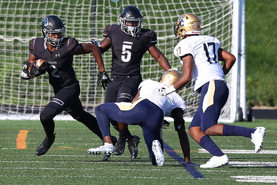 George P. Smith/The Montgomery Sentinel    Northwest High School's Andrew Howard (2) cuts back against Our Lady of Good Counsel High School during a punt return in the game played at Gaithersburg High School on Saturday, September 29, 2018 due to wet field conditions at Northwest.