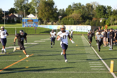 George P. Smith/The Montgomery Sentinel    Our Lady of Good Counsel High School's Mitchell Melton (17) gets to the endzone untouched against Northwest High School to put the Falcons up 41-0 with 4:20 left in the 2nd quarter of the game played at Gaithersburg High School on Saturday, September 29, 2018 due to wet field conditions at Northwest.