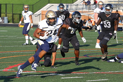George P. Smith/The Montgomery Sentinel    Our Lady of Good Counsel High School's Mehki Smith (24) enroute to scoring a touchdown against Northwest High School in the game played at Gaithersburg High School on Saturday, September 29, 2018 due to wet field conditions at Northwest.