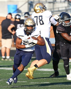 George P. Smith/The Montgomery Sentinel    Our Lady of Good Counsel High School's Mehki Smith (24) carrying the ball agaimst Northwest High School in the game played at Gaithersburg High School on Saturday, September 29, 2018 due to wet field conditions at Northwest.