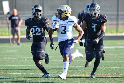 George P. Smith/The Montgomery Sentinel    Our Lady of Good Counsel High School's  Sy'Veon Wilkerson (3) blows through the Northwest line en route to another Falcon touchdown in the game played at Gaithersburg High School on Saturday, September 29, 2018 due to wet field conditions at Northwest.