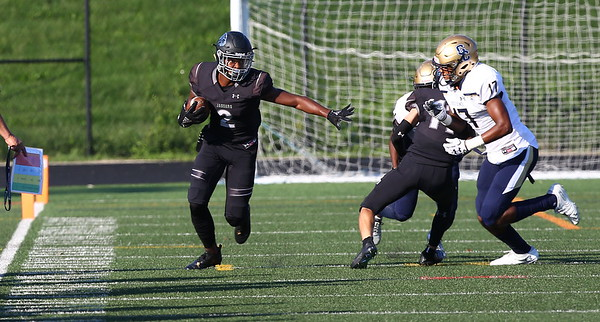 George P. Smith/The Montgomery Sentinel    Northwest High School's Andrew Howard (2) gets ready stiff arm Good Counsel's Mitchell Melton (17) coming up fast to drive him out of bounds  in the game played at Gaithersburg High School on Saturday, September 29, 2018 due to wet field conditions at Northwest.