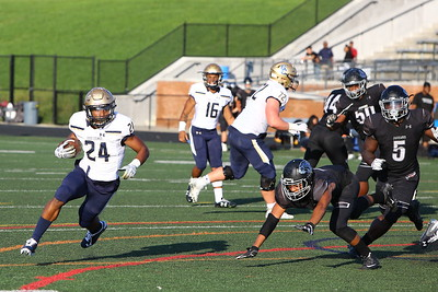 George P. Smith/The Montgomery Sentinel    Our Lady of Good Counsel High School's Mehki Smith (24) turns the corner on Northwest High School in the game played at Gaithersburg High School on Saturday, September 29, 2018 due to wet field conditions at Northwest.