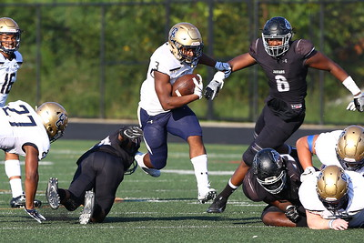 George P. Smith/The Montgomery Sentinel    Our Lady of Good Counsel High School's Sy'Veon Wilkerson (3) runs through a huge hole in the Northwest High School line in the game played at Gaithersburg High School on Saturday, September 29, 2018 due to wet field conditions at Northwest.
