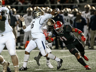 St. Johns' Christian Taylor set his sites on Good Counsel Quarterback Kam Snell. Taylor was called for roughing the passer. PHOTO BY MIKE CLARK