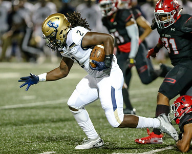 Good Counsel's Latre Kornegay rips off a long run on the first play from scrimmage. PHOTO BY MIKE CLARK
