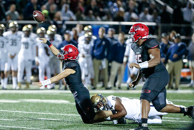 Good Counsel's Jalen Green brings down St. Johns' Quarterback Sol-Jay Maiava but not before Maiava got the pass off for a 10-yard gain. PHOTO BY MIKE CLARK