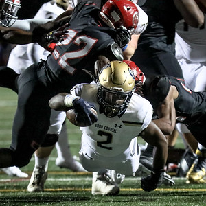 Latrele Palmer dives for this first half first down. St. John's defense shut down Palmer and the rest of the Good Counsel offense.  PHOTO BY MIKE CLARK