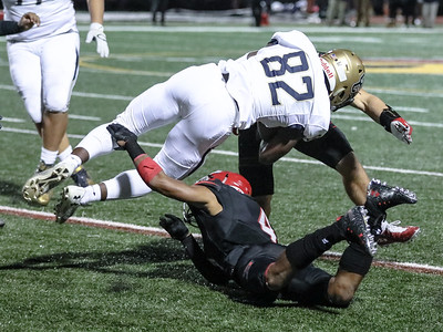 Good Counsel's Latre Kornegay pays the price on this play. The St. Johns defense shut out Good Counsel in the 2nd half. PHOTO BY MIKE CLARK