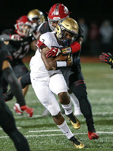 The top-ranked DC-area team, St. Johns, shuts out Good Counsel in the second half for a 31-10 win. PHOTO BY MIKE CLARK