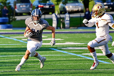 George P. Smith/The Montgomery Sentinel    Georgetown Prep's Emmett Scanlon (81) carries the ball as Landon's Jalen Williams (1) gives pursuit.