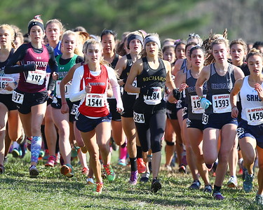George P. Smith/The Montgomery Sentinel    Eventual winner,  Richard Montgomery High School's Charlotte Turesson (1283), lets her teammate (1284) draft for her at the start of the 4A Classification of the State Cross Country Championship.