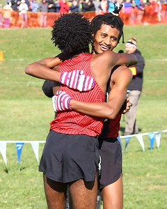 George P. Smith/The Montgomery Sentinel    Northwood High School's Obsaa Feda (facing) (15:44.05) hugs his teammate Eldad Mulugeta(15:44.29) after finishing 1st and 2nd in the 4A Boys Division of the Maryland State Public School's Cross Country Championship held at Hereford High School on Saturday, November 10, 2018.